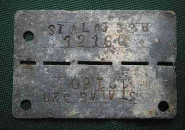 Ідентифікаційний жетон військовополоненого, знайдений на території колишнього табору для військовополонених.